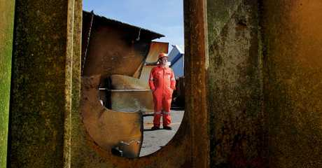 Frank Leckey, salvage master for Resolve Wreckage and Fire, stands amongst the hundreds on tons of steel removed from the ship, Rena. 