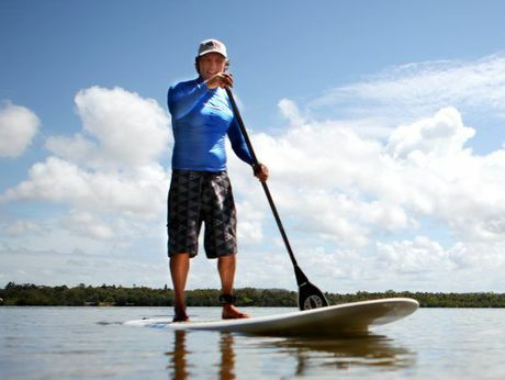 Pat Eastwood on a stand up paddle board. Photo Allan Reinikka / The Morning Bulletin