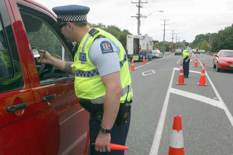 TIME TO CHANGE: Officers at a Masterton checkpoint. Police say drivers need to change their attitude towards drink-driving.