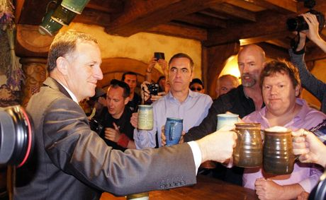 New Zealand Prime Minister John Key toasts the cast of The Hobbit: An Unexpected Journey at The Green Dragon pub in Hobbiton.