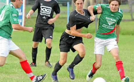 DEFENCE STRETCHED: An Italo Stars defender tries the shirt tackle.
