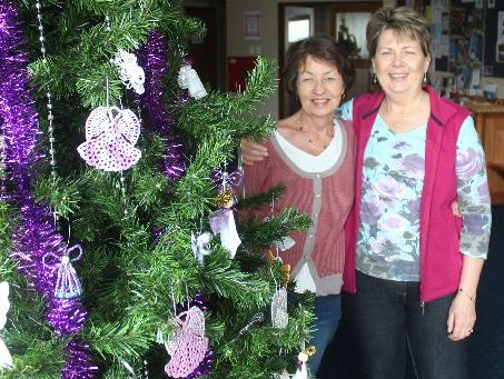 Yvonne Hewitt, left, and Christine Wagstaff are part of the Nimble Fingers craft group that spends all year making Christmas tree decorations.