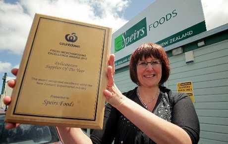 WINNER GRINNER: Trudy Westwood, sales and marketing head for Speirs Foods in Marton, shows off the plaque singling out the company as Countdown's best delicatessen supplier for this year. PHOTO/STUART MUNRO