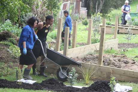 Tangaroa College students hard at work in the garden.