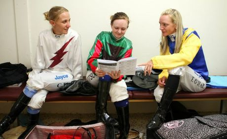 Jockey's Carly-Mae Pye, Alexandra Kitson and Tracey O'Hara relaxing between races. Photo Allan Reinikka / The Morning Bulletin