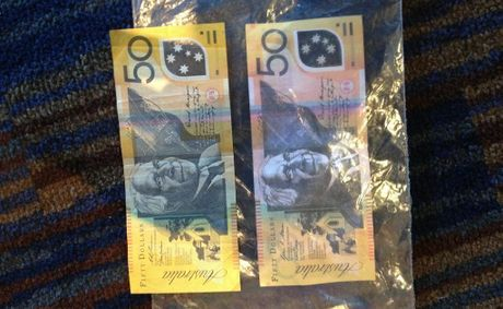 A counterfeit $50 bill was used at South Tweed Tavern. The slightly discoloured fake note is visible through the plastic bag. Photo: Emma Galliott / Daily News