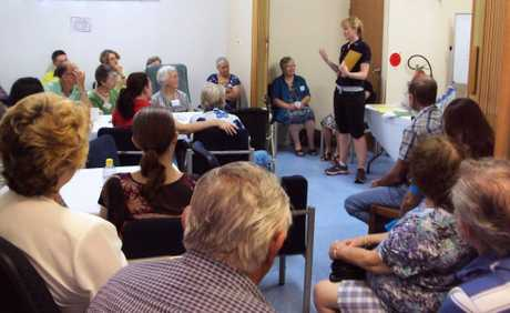 LEARNING: The group listens intently to how to prevent falls at home.