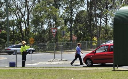 A woman returns to her car after abusing the traffic control along the Bruxner Highway near the media centre.