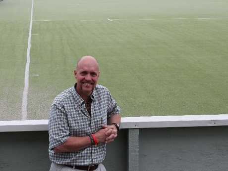 Tauranga Hockey Association general manager Clyde du Toit in front of the worn out old hockey turf at Blake Park. Photo / Peter White