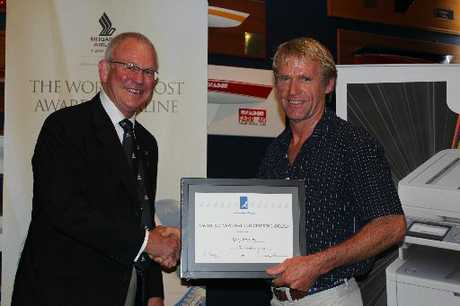 Kerry Farrand receives his award from Steve Barrett, the Commodore of the Royal New Zealand Yacht Squadron, at the YNZ awards ceremony. Photo / Supplied