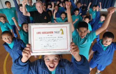 Malfroy School has been part of the Life Education Trust's programme for 20 years. Trust ambassador Dionne Tuhakaraina proudly holds the school's certificate of appreciation. Photo / Stephen Parker