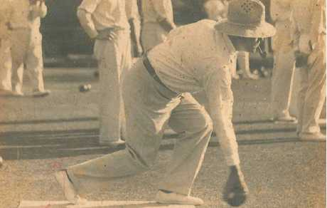 TIMES PAST: With his characteristic pipe in his mouth, the late Alan Luck crouches into position on the green at City Bowls Club more than three decades ago. Mr Luck was a former principal of Victoria Park State School.