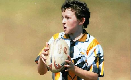 KEEN ON SPORT: Mackay schoolboy Darcy Webb-Smith in action at touch football.