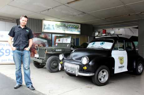WICKED WHEELS: Lance Streeter with Cars lookalikes Sarge and Sheriff, which attracted attention outside Streeter Concepts Signwriting and Design yesterday. PHOTO/REBECCA RYAN
