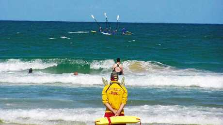FAREWELL: The Coolum boat crew raises its oars to salute Les Wilson's life.