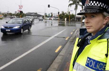 Whangarei police Strategic Traffic Unit Constable Sandra Mortensen keeps an eye out for motorists talking on their cellphones at Whangarei Town Basin yesterday. Photo / John Stone