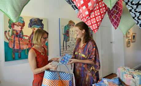 Loading up a shopping bag is (left) Blockwork Gallery director Sally Johnston, with Feather &amp; Buzz co-owner Anna Chandler. The online store will be selling their goods at a pop up shop at the gallery tonight and tomorrow.