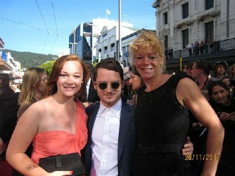 RED CARPET COOL: Tessla Grunwald with Elijah Wood and her mum Tanja Grunwald at the premiere of The Hobbit: An Unexpected Journey. BELOW: With TVNZ weatherman Tamati Coffey. PHOTOS/ SUPPLIED