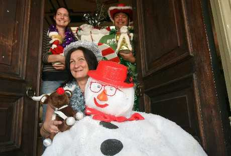 FESTIVE SPIRIT: Masterton Christian Childcare supervisor Suzie Wilmshurst with volunteers Jo Scott and Jonnie Samia at the door of their Christmas Wonderland - open for festivities tomorrow.
