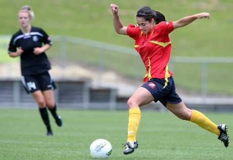 KICK AND CHASE: WaiBop women's footballer Jess Clark (right) in action against Northern Football last weekend in Rotorua. Clark's team take on Auckland in a bid to make next weekend's semi-finals.