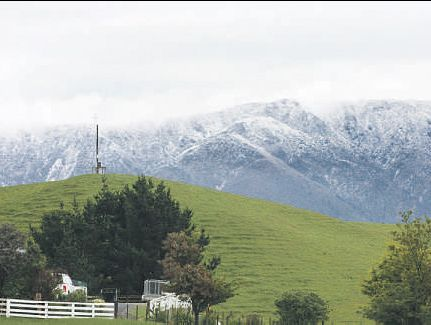 Welcome to summer - Dannevirke-style. As temperatures crashed overnight on Thursday, Dannevirke residents woke yesterday morning to find it snowing along the Ruahine Range - a big difference from sweltering temperatures the day before.