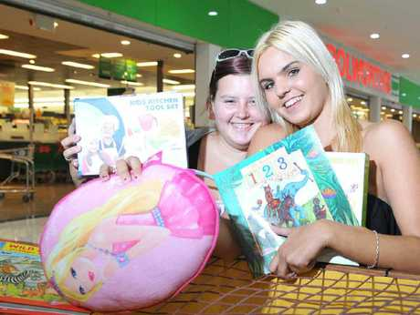 CHRISTMAS SPIRIT: Sophie and Tamika Neumann are supporting the annual Ulysses toy run, which collects toys for young children at Brassall Shopping Centre.