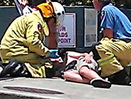 FIREFIGHTERS HELP: The scene of a crash between a skateboarder and a car in Maroochydore.