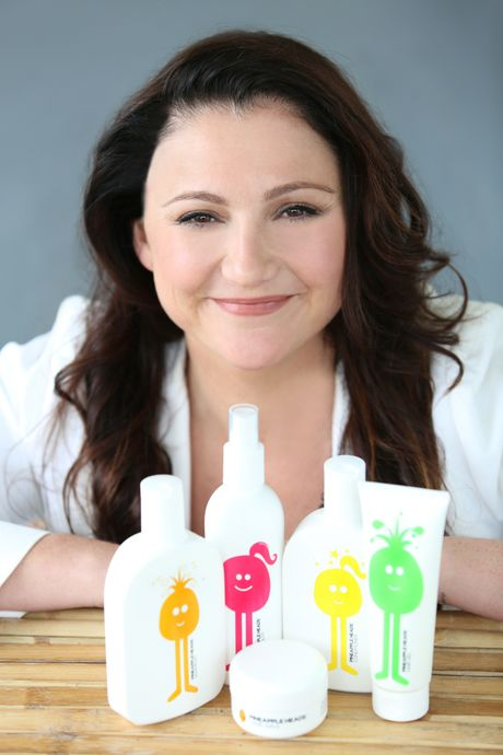 Auckland advertising executive Megan Sanders with her Pineapple Heads range of products.