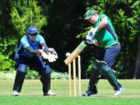 CD captain Rachel Priest shows the way with the bat on Saturday as Auckland skipper Victoria Lind anticipates a catch in Masterton. Photo / APN