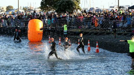 STROKING AHEAD: The orange-hat swimmers start the second lap during the Ironmaori event starting at Pandora Pond, Napier. PHOTO/ GLENN TAYLOR