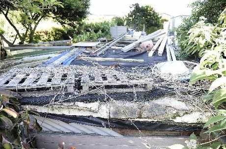 Gary Lochhead says his neighbour's unpermitted sheds are an eyesore and a danger to his family. PHOTO: 281112GN45BOP