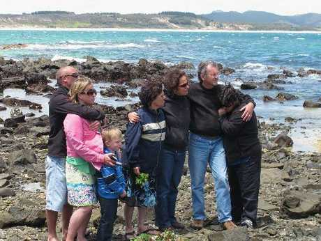 "Members of William Macrae's family comfort each other during the ceremony at Maraewhiti Point on the Karikari Peninsula to remember Mr Macrae and John ""Prickles"" de Ridder."
