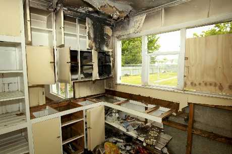 A suspicious fire in an abandoned kitchen could have quickly destroyed the block of four two-storeyed units due to gale-force winds on Saturday night.