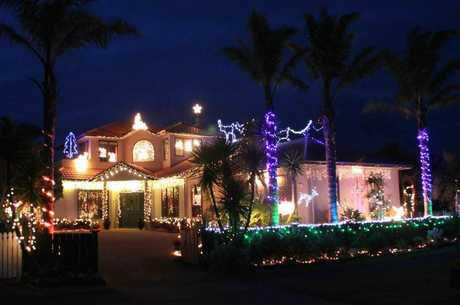 Waihi Beach's Kev and Colleen Low put on a dazzling Christmas lights display last year.