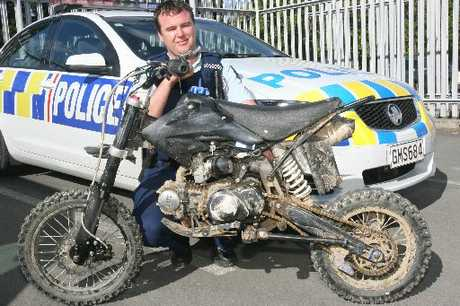 HOT PROPERTY: Constable Rob Hutton with the stolen Lifan pit bike at Masterton Police Station.