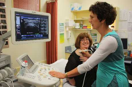 LATEST TECHNOLOGY: Annie Poulton (right), the sonographer at the privately owned Dannevirke Community Hospital, scans the shoulder of Chrissy Shead, hospital manager on the new IU22 ultrasound machine which came into service last week. PHOTO/CHRISTINE MCKAY DAN12823