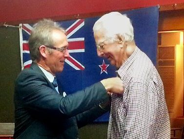 Rotary Club president Chris Kay presents Paul Hobbs with his Sapphire Pin.
