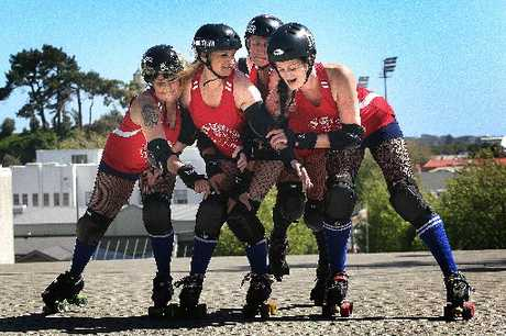 UP FOR THE FRIGHT: The River City Rollers practising for Saturday night's match with Levin's Whenua Fatales. From left, Julie Jackson (aka Murderhouse Mouse), Sophie Kojis (Sophie O'Path), Emma Canden (Crystal Crush-Her) and Melanie McGhie (Mel-icious Mayhem). PHOTO/BEVAN CONLEY