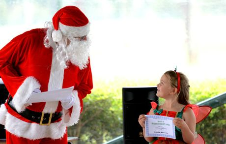 Burringbar public school, kids idol competition. Special guest judge Santa talks to Lilly Steele. Photo: John Gass / Daily News