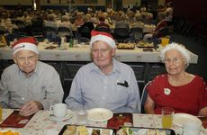The annual Mayor's Over 80's Christmas party at the Clive Berghofer Recreation Centre, from left; Cecil Lusk, Dr Daryl Ellomore and Mavis Wilson. Photo: Bev Lacey / The Chronicle