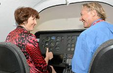 Flight instructor Mark Munn with MP Fiona Simpson.