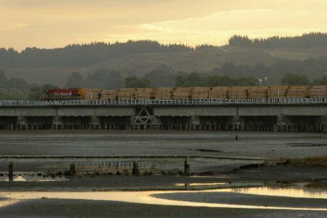 FINAL GLIMPSE: The area's last freight train, carrying sawn timber in 12 wagons to Napier, travels on the Ahuriri estuary rail bridge. HBT124328-5