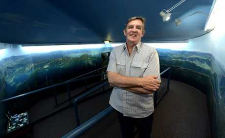 Andy Reimanis with the finished mural at Murwillumbah visitor centre. Photo: John Gass / Daily News