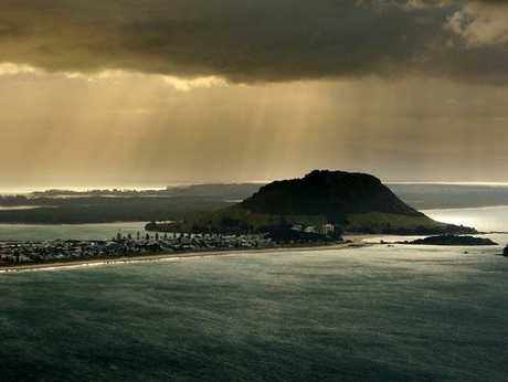 Storm clouds above Tauranga Harbour and Mount Maunganui beach.