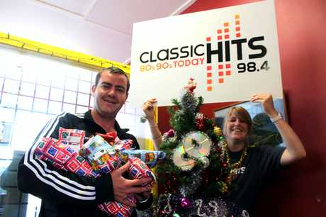 HELP US: Waitaki Classic Hits breakfast host Sam Wilson and promo girl Jahana McLay, are reaching out for assistance to make Christmas merry for Oamaru families who need help. PHOTO/REBECCA RYAN