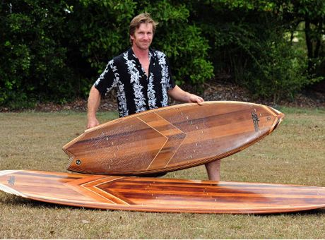 ALL WOOD: Steve Halpin with his wooden surfboards, including recycled timber blinds.