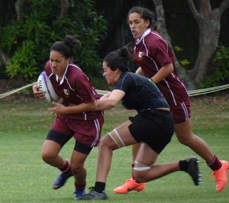 HARD TO STOP: Standout Kaitaia College ball carrier Arerina Ihaka-Pereira, who scored several tries, is supported by Justice Karena, later taken to hospital with serious concussion, during the Condor Rugby Sevens at Auckland during the weekend.
