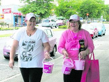 Gaeleen Scholes-Daysh (left) and Patrina Lawes head along Alexandra Street to collect donations. The pair are embarking on a fundraising trip that will take them all the way to Stewart Island.