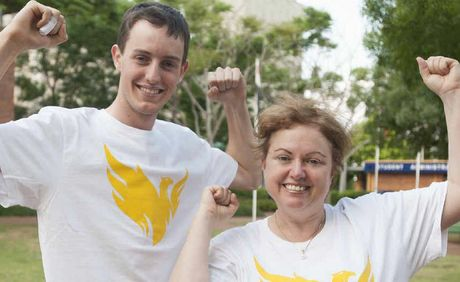 "Warwick local Alex Darton poses for a photo in the new ""Phoenix"" t-shirts with USQ Vice-Chancellor Professor Jan Thomas."