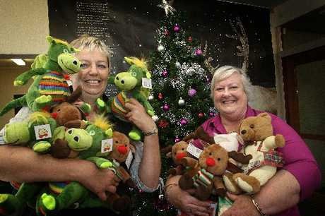 HOLIDAY CHEER: Louisa Hewitt from the Wanganui Chronicle and Barbara Young from Birthright Wanganui with some of the toys donated for disadvantaged Wanganui children. PHOTO/BEVAN CONLEY